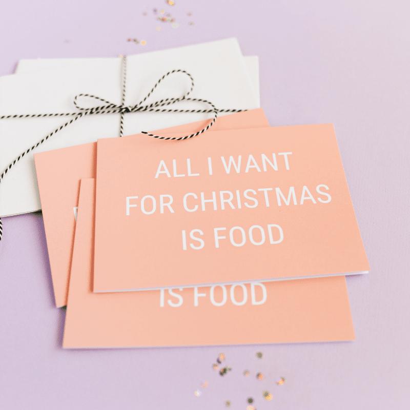 kerstkaart-vn-gekkiggeit-met-de-tekst-all-I-want-for-christmas-is-food-close-up